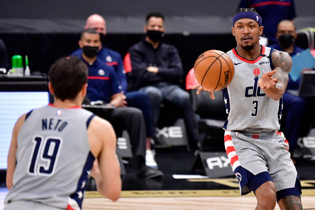 TAMPA, FLORIDA - MAY 06: Bradley Beal #3 of the Washington Wizards looks to pass the ball to Raul Neto #19 during the second quarter against the Toronto Raptors at Amalie Arena on May 06, 2021 in Tampa, Florida