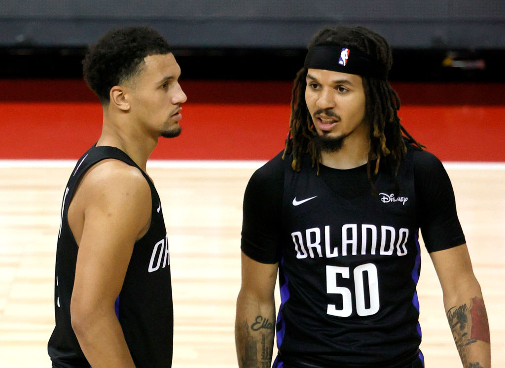 LAS VEGAS, NEVADA - AUGUST 09: Jalen Suggs #4 and Cole Anthony #50 of the Orlando Magic talk on the court during a break in their game against the Golden State Warriors during the 2021 NBA Summer League at the Thomas & Mack Center on August 9, 2021 in Las Vegas, Nevada. The Magic defeated the Warriors 91-89 in overtime