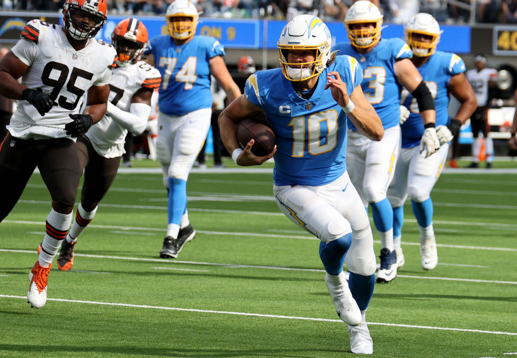 INGLEWOOD, CALIFORNIA - OCTOBER 10: Justin Herbert #10 of the Los Angeles Chargers scrambles out of the pocket and runs for a touchdown during the third quarter against the Cleveland Browns at SoFi Stadium on October 10, 2021 in Inglewood, California